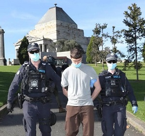 image: man arrested for covid protest